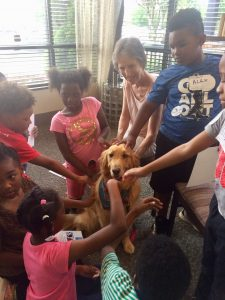 Children with a rescue dog